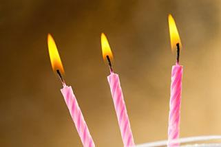 Three burning birthday candles
